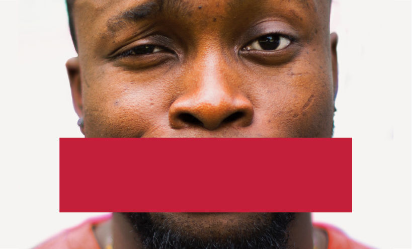 image of man with critical expression on face and a red banner over his mouth